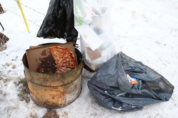 Trash, including a half-eaten pizza, is shown at the entrance to the Malheur National Wildlife Refuge headquarters, occupied by anti-government protesters, near Burns, Ore. on Thursday, Jan. 7, 20 ...