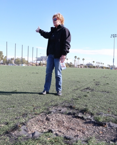 Clark County Parks & Recreation Department Assistant Director, Mindy Meyers, speaks standing next to damaged artificial turf soccer field at 5800 Surrey Street, Near Russell Road between Maryl ...