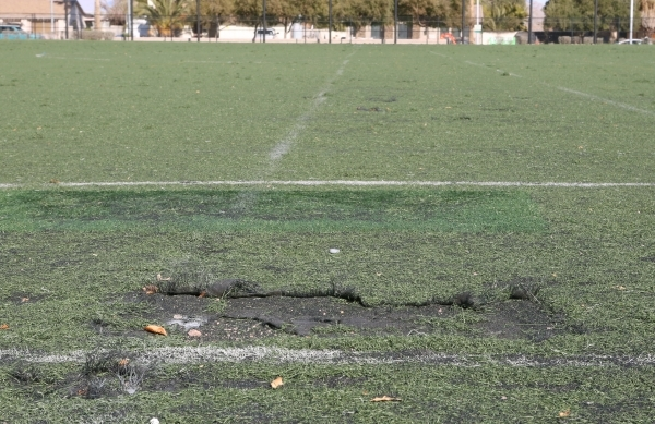 Damaged artificial turf soccer field at 5800 Surrey Street, Near Russell Road between Maryland Parkway and Eastern Avenue is seen on Friday, Jan. 8, 2016. Two soccer fields near McCarran Airport h ...
