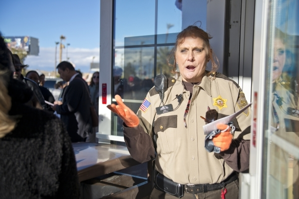 Security officer Dana stands at the front entrance of the Primm Valley Lotto Store just over the California border near Primm on Friday, Jan. 8, 2016. (Daniel Clark/Las Vegas Review-Journal)