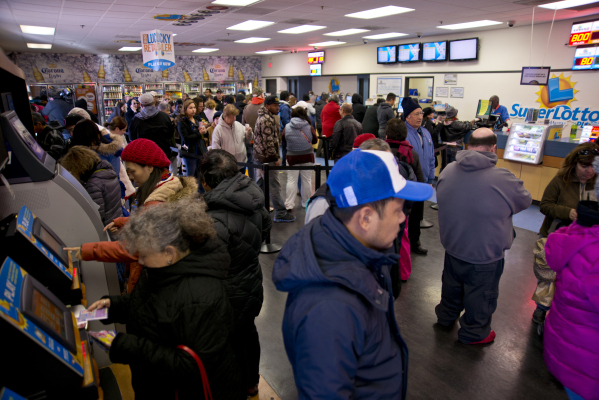 People buy lottery tickets inside the Primm Valley Lotto Store just over the California border near Primm on Friday, Jan. 8, 2016. (Daniel Clark/Las Vegas Review-Journal)