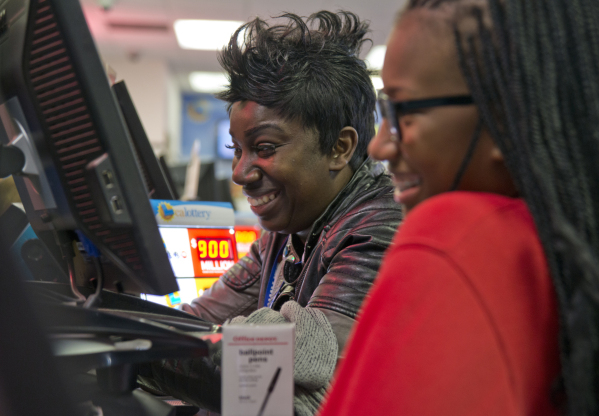 Sandra Moore, left, and her daughter Armani buy lottery tickets inside the Primm Valley Lotto Store just over the California border near Primm on Friday, Jan. 8, 2016. (Daniel Clark/Las Vegas Revi ...