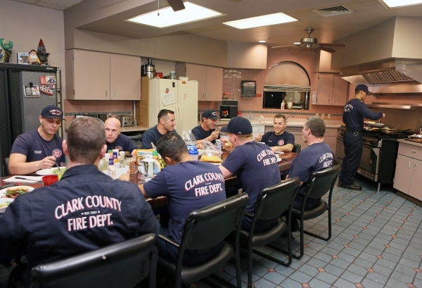 Men gather for B Platoon dinner at Clark County Fire Department Station 17 Monday, Jan. 11, 2016, in Las Vegas. Each platoon contributes a daily fee that goes towards meals that the firefighters c ...