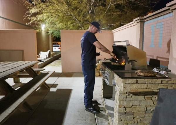 Firefighter and paramedic Chris Cornell prepares tri-tip on the grill for a B Platoon dinner at Clark County Fire Department Station 17 Monday, Jan. 11, 2016, in Las Vegas. Each platoon contribute ...