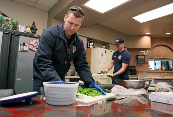 Firefighters Colin Kelley, left, and paramedic Chris Cornell prepare dinner for B Platoon at Clark County Fire Department Station 17 Monday, Jan. 11, 2016, in Las Vegas. Each platoon contributes a ...