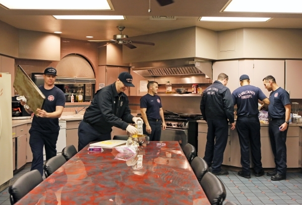 Firefighters assist in food prep for a B Platoon dinner at Clark County Fire Department Station 17 Monday, Jan. 11, 2016, in Las Vegas. Each platoon contributes a daily fee that goes towards meals ...