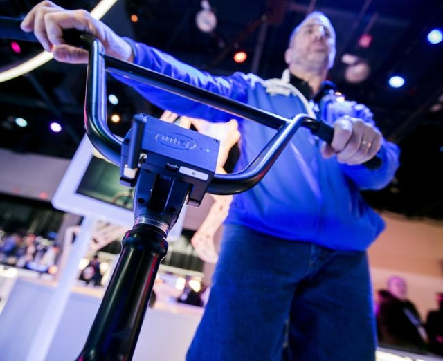 Gary Klein explains the Smart BMX bike at the Intel booth during CES in the Las Vegas Convention Center on Friday, Jan. 8,2016. An Intel microcomputer attached to the bike captures data of the rid ...