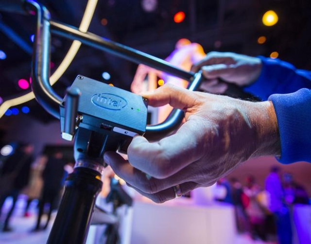 Gary Klein touches the module on the Smart BMX bike at the Intel booth during CES in the Las Vegas Convention Center on Friday, Jan. 8,2016. An Intel microcomputer attached to the bike captures da ...