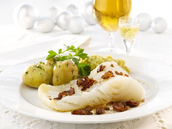 Lutefisk is served here with potatoes and bacon. While once a popular Scandinavian dish, it is now mainly found during ethnic celebrations in church basements and lodge halls in the U.S.  (Photo b ...