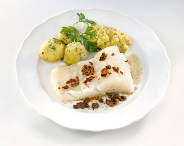 Lutefisk is served here with potatoes and bacon. While once a popular Scandinavian dish, it is now mainly found during ethnic celebrations in church basements and lodge halls in the U.S. (Photo by ...
