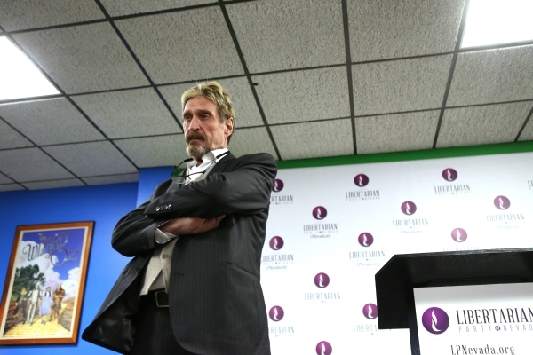 John McAfee, computer programmer and developer running for the Libertarian Party nomination for president, speaks during a press conference at the Libertarian Party of Nevada Headquarters on Frida ...