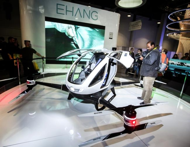 A videographer films Ehang's autonomous helicopter on display during CES in the Las Vegas Convention Center on Friday, Jan. 8,2016. The all-electric quadcopter drone is the size of a subcomp ...