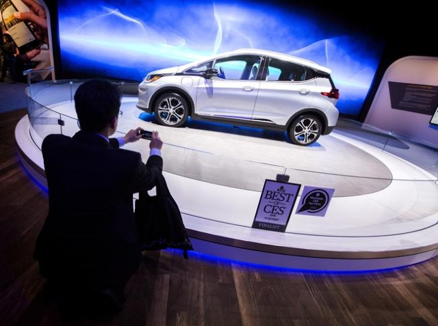 A man photographs the Bolt EV at the Chevrolet booth during CES in the Las Vegas Convention Center on Friday, Jan. 8,2016. The all-electric car was unveiled at CES this week.Jeff Scheid/Las Vegas  ...