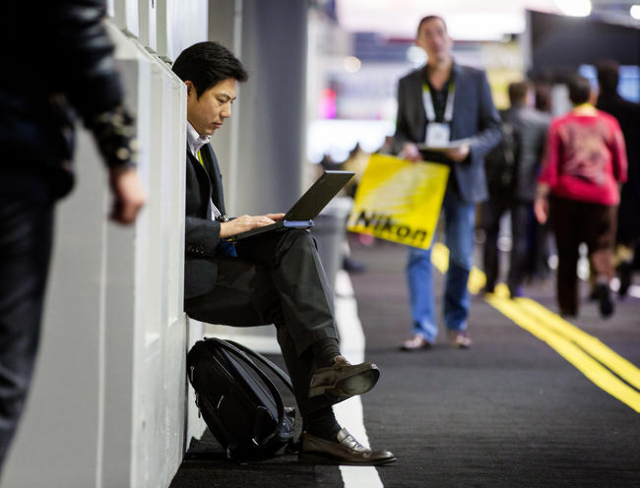 A man sits in a nook while viewing his computer during CES in the Las Vegas Convention Center on Friday, Jan. 8,2016. Jeff Scheid/Las Vegas Review-Journal Follow him @jlscheid