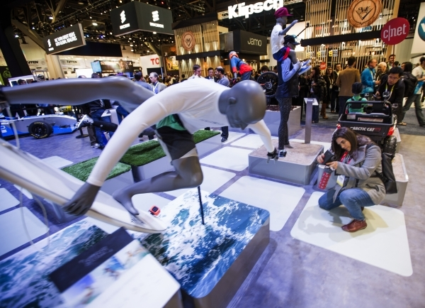 A woman takes a photo of a display in the GoPro booth during CES at the Las Vegas Convention Center on Thursday, Jan. 7,2016. Jeff Scheid/Las Vegas Review-Journal Follow him @jlscheid