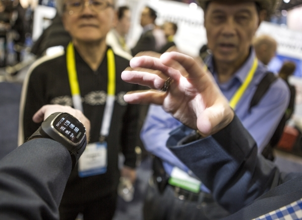 Jeff Ray, executive director of business and technology, gestures while explaining the Project Zero Wrist Monitor in the Omron booth during CES at the Sands Expo on Thursday, Jan. 7,2016. The medi ...