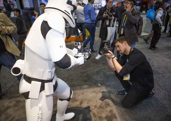 Adam Sewell shoots video of a 3D print out of a Star Wars Stormtropper  in the 3D Systems booth during CES at the Las Vegas Sands Expo on Thursday, Jan. 7,2016. Jeff Scheid/Las Vegas Review-Journa ...