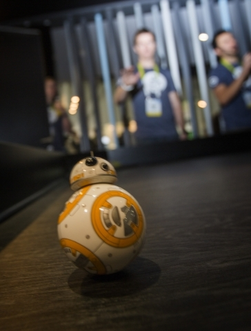 Bryn Rowe demonstrates the  BB-8 drone in the Sphero booth during CES in the Las Vegas Convention Center on Friday, Jan. 8,2016. The drone is controlled by using gestures from a wristband.  Jeff S ...