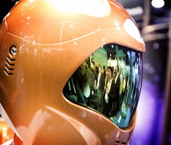 A reflection of conventioneers astronaut helmet in the NASA booth during CES in the Las Vegas Convention Center on Friday, Jan. 8,2016.  This is the first time NASA has been to CES and is using bo ...