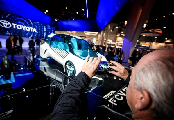 A man takes a photo of the FCV Plus concept car in the Toyota booth during CES in the Las Vegas Convention Center on Friday, Jan. 8,2016. The automobile runs on hydrogen fuel cells. Jeff Scheid/La ...