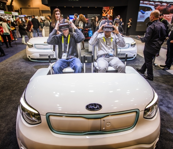 Men take a virtual reality ride in the Kia booth during CES in the Las Vegas Convention Center on Friday, Jan. 8,2016. Jeff Scheid/Las Vegas Review-Journal Follow him @jlscheid
