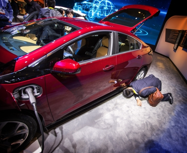 A man looks at the undercarriage of a 2016 all electric Volt at the Chevrolet booth during CES in the Las Vegas Convention Center on Friday, Jan. 8,2016. Jeff Scheid/Las Vegas Review-Journal Follo ...
