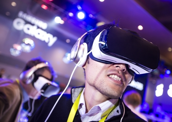 Takahiko Date wears goggles while watching a virtual reality presentation in the Samsung Gear booth during CES at the Las Vegas Convention Center on Thursday, Jan. 7,2016. Jeff Scheid/Las Vegas Re ...