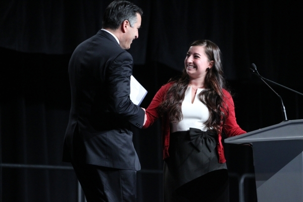 Gov. Brian Sandoval, left, is introduced by Kanani Espinoza, UNLV student body president, during an event to celebrate preparations for the 2016 and final presidential debate at UNLV at Cox Pavili ...