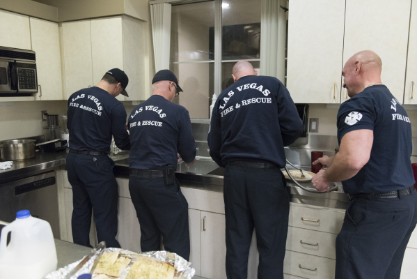 The crew washes dishes used for dinner at Las Vegas Fire & Rescue's Fire Station 41 in Las Vegas Monday, Jan. 11, 2016. Jason Ogulnik/Las Vegas Review-Journal