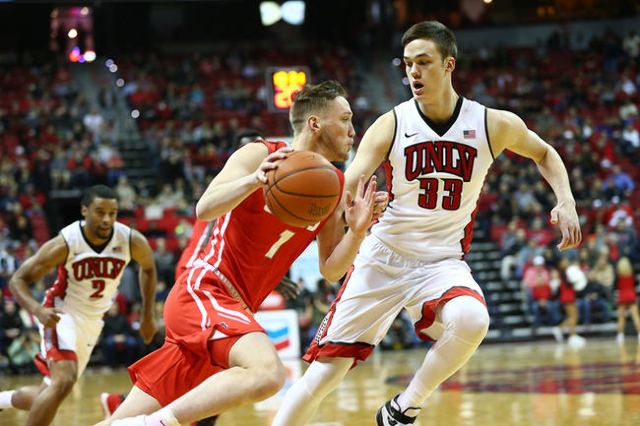 UNLV forward Stephen Zimmerman Jr. (33) defends New Mexico guard Cullen Neal (1) during a basketball game at the Thomas & Mack Center in Las Vegas on Tuesday, Jan. 12, 2016. Chase Stevens/Las  ...