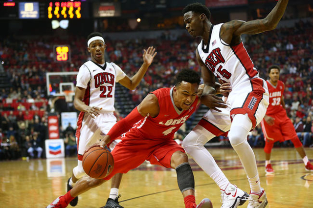 New Mexico guard Elijah Brown (4) drives against UNLV forward Dwayne Morgan (15) as UNLV guard Patrick McCaw (22) looks on during a basketball game at the Thomas & Mack Center in Las Vegas on  ...