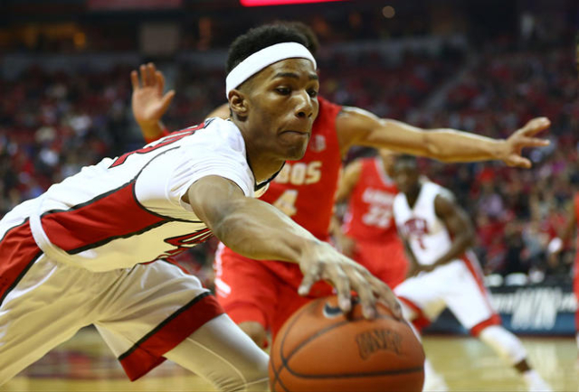 UNLV guard Patrick McCaw (22) attempts to save a loose ball against New Mexico during a basketball game at the Thomas & Mack Center in Las Vegas on Tuesday, Jan. 12, 2016. Chase Stevens/Las Ve ...