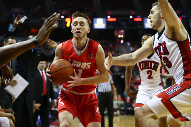 UNLV forward Derrick Jones Jr. (1) is pressed by UNLV defense, including UNLV forward Ben Carter (13), right, during a basketball game at the Thomas & Mack Center in Las Vegas on Tuesday, Jan. ...