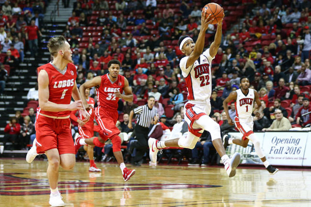 UNLV guard Patrick McCaw (22) catches a pass as New Mexico guard Cullen Neal (1) and New Mexico forward Tim Williams (32) run up court during a basketball game at the Thomas & Mack Center in L ...