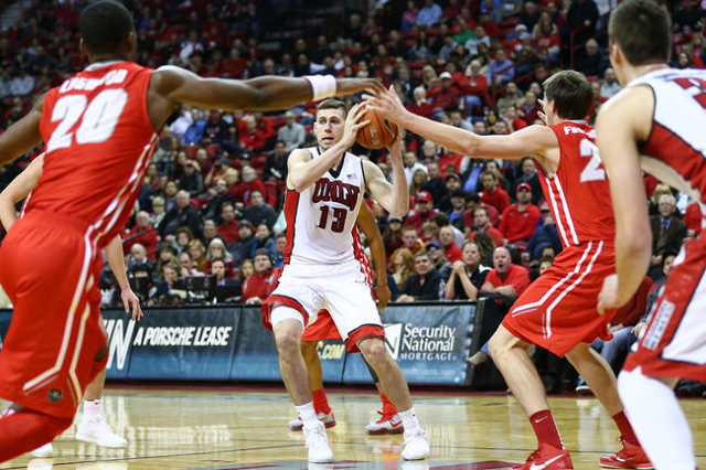 UNLV forward Ben Carter (13) looks for an open pass as New Mexico guard Sam Logwood (20) and forward Joe Furstinger (23) defend during a basketball game at the Thomas & Mack Center in Las Vega ...