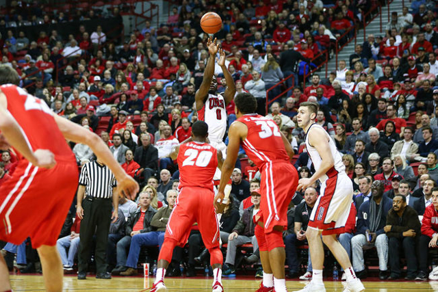 UNLV guard Ike Nwamu (0) shoots to score a three-pointer against New Mexico during a basketball game at the Thomas & Mack Center in Las Vegas on Tuesday, Jan. 12, 2016. UNLV won 86-74. Chase S ...