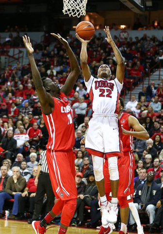 UNLV guard Patrick McCaw (22) gets to the basket to score against New Mexico center Obij Aget (11) during a basketball game at the Thomas & Mack Center in Las Vegas on Tuesday, Jan. 12, 2016.  ...