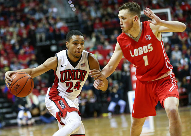 UNLV guard Jalen Poyser (24) drives against New Mexico guard Cullen Neal (1) during a basketball game at the Thomas & Mack Center in Las Vegas on Tuesday, Jan. 12, 2016. UNLV won 86-74. Chase  ...