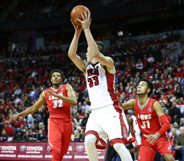 UNLV forward Stephen Zimmerman Jr. (33) catches a pass as New Mexico forward Tim Williams (32) and guard Anthony Mathis (31) defend during a basketball game at the Thomas & Mack Center in Las  ...
