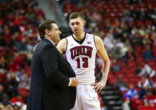 UNLV interim head coach Todd Simon talks with UNLV forward Ben Carter (13) as the team plays New Mexico during a basketball game at the Thomas & Mack Center in Las Vegas on Tuesday, Jan. 12, 2 ...