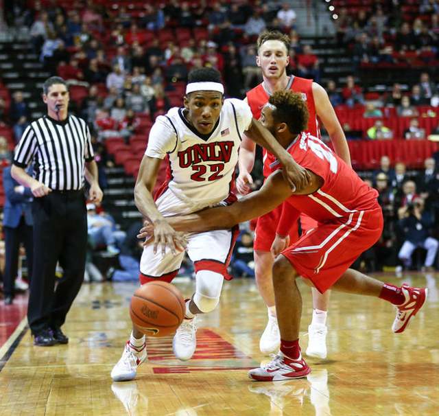 UNLV guard Patrick McCaw (22) is fouled by New Mexico guard Xavier Adams (21) during a basketball game at the Thomas & Mack Center in Las Vegas on Tuesday, Jan. 12, 2016. UNLV won 86-74. Chase ...