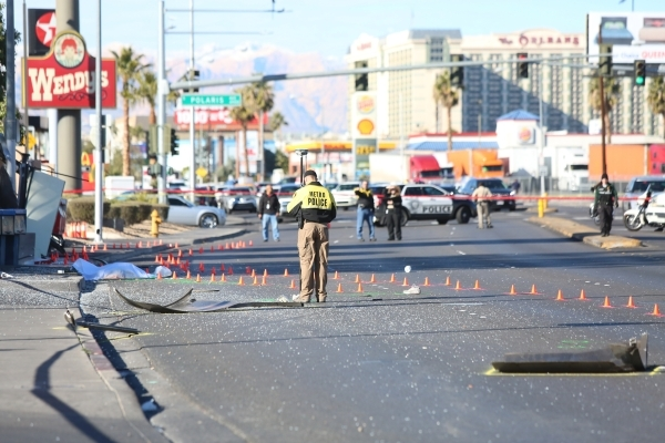 Las Vegas Police use cones to track the path of the bus that hit a bus stop in a fatal accident on West Tropicana Avenue near Dean Martin Drive in Las Vegas on Saturday, Jan. 9, 2016. Brett Le Bla ...