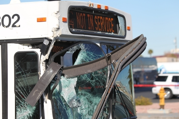 A metal piece of a bus stop sticks out the front of the bus involved in a fatal accident on West Tropicana Avenue near Dean Martin Drive in Las Vegas on Saturday, Jan. 9, 2016. Brett Le Blanc/Las  ...