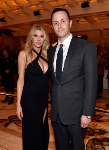 Wynn Las Vegas executive Sean Christie and model Charlotte McKinney attend Wednesday's grand opening of Encore Players Club.   Courtesy of David Becker/Getty Images.