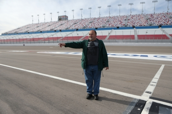 Rick Rosen, a local bus safety advocate, talks about the pit spot barrier at the Las Vegas Motor Speedway on Thursday, Jan. 14, 2016, in Las Vegas. Rosen and a partner are developing a prototype o ...