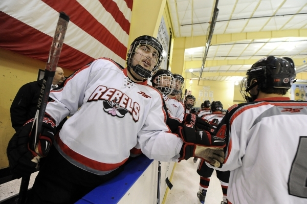 UNLV club hockey forward Richie Crossley, left, and teammates high five defenseman Drew Bryan after a UNLV goal in the first period of their game against San Diego State at Sobe Ice Arena inside t ...