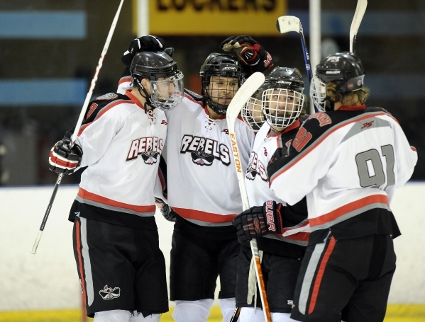 UNLV club hockey teammates high five each other after a UNLV goal in the first period of their game against San Diego State at Sobe Ice Arena inside the Fiesta hotel-casino in Las Vegas Saturday,  ...