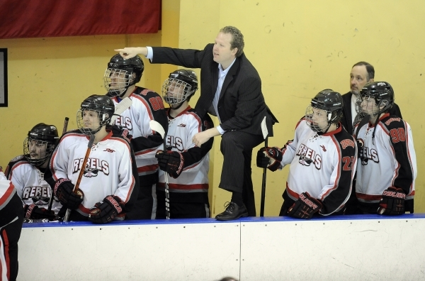 UNLV club hockey head coach J.J. Hartmann yells at the officials in the second period of their game against San Diego State at Sobe Ice Arena inside the Fiesta hotel-casino in Las Vegas Saturday,  ...