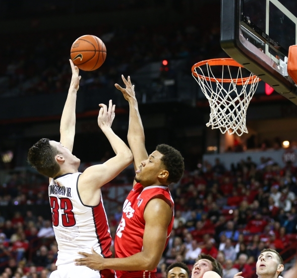 UNLV forward Stephen Zimmerman Jr. (33) attempts a shot over New Mexico forward Tim Williams (32) during a basketball game at the Thomas & Mack Center in Las Vegas on Tuesday, Jan. 12, 2016. U ...