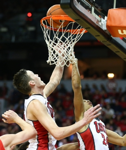 UNLV forward Stephen Zimmerman Jr. (33) helps tip in a shot by UNLV guard Jalen Poyser (24) against New Mexico during a basketball game at the Thomas & Mack Center in Las Vegas on Tuesday, Jan ...